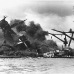 The battleship USS ARIZONA sinking after being hit by Japanese air attack on Dec. 7,1941.