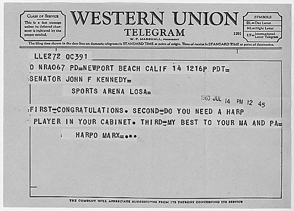 Harpo Marx congratulates John F. Kennedy